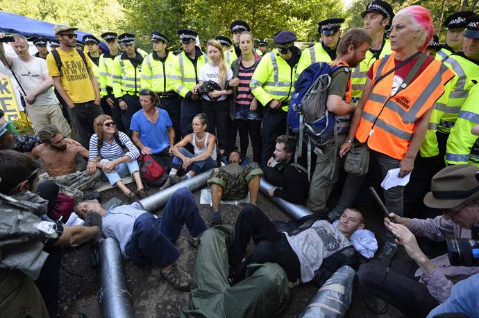 Demonstrators lock themselves together during a protest outside a drill site run by Cuadrilla Resources, near Balcombe in southern England